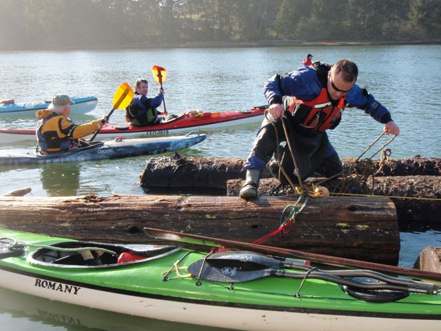 Mark Whitaker, securing the logs together at the Nehalem boat ramp.