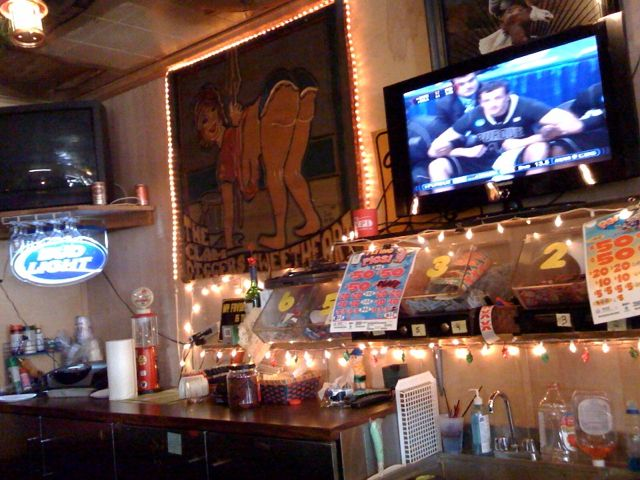"""The Aloha Tavern. Painting on the left: """"The Clam Digger's Sweetheart""""."""