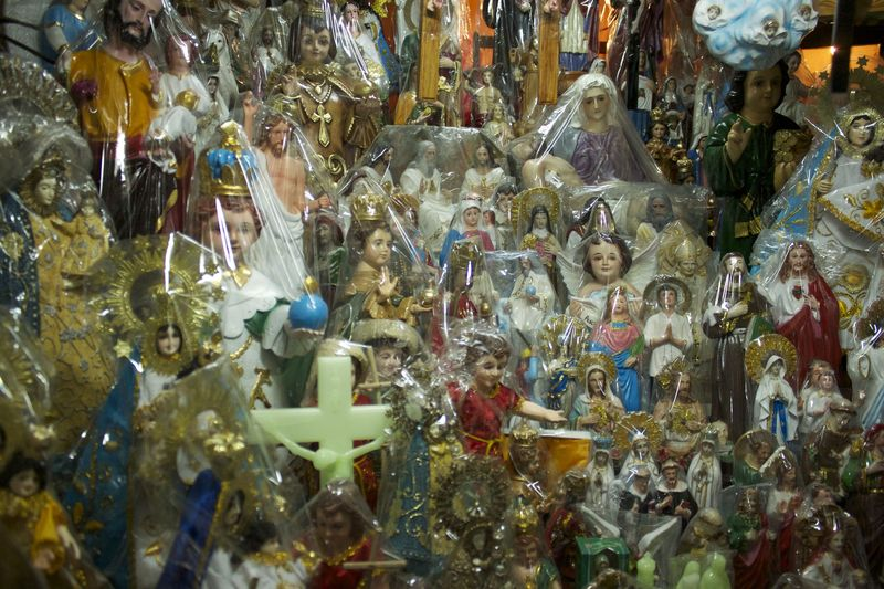 The Catholic Pantheon: a multitude of heavenly plastic statues for sale in the market surrounding the church.