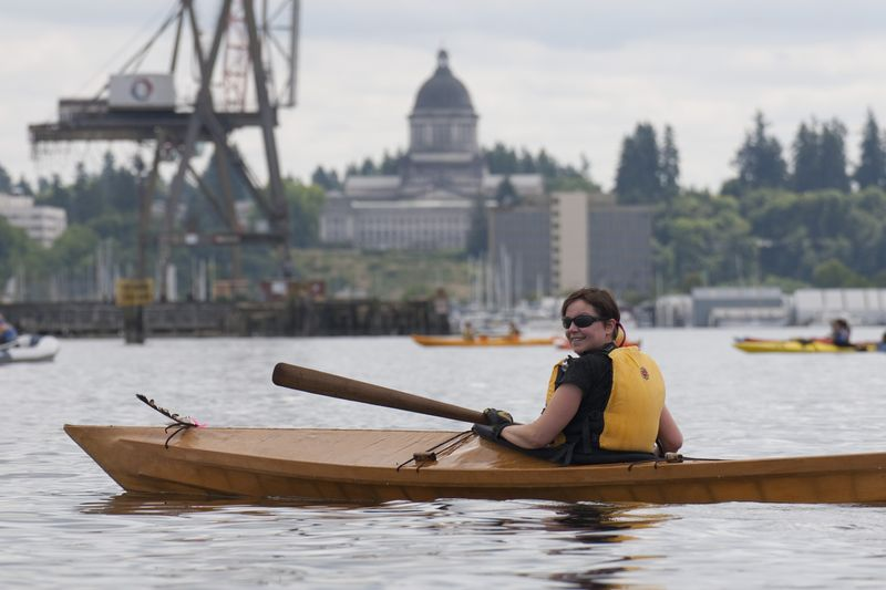 Katya awaits arrival of the canoes, the state capitol building in the background.
