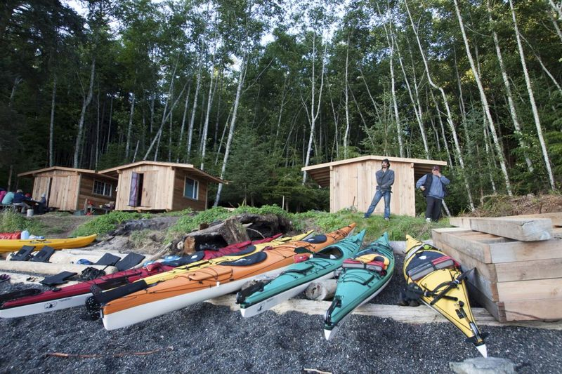 Darcy and Tom among the cabins and kayaks on Compton Island. Photo © Katya Palladina