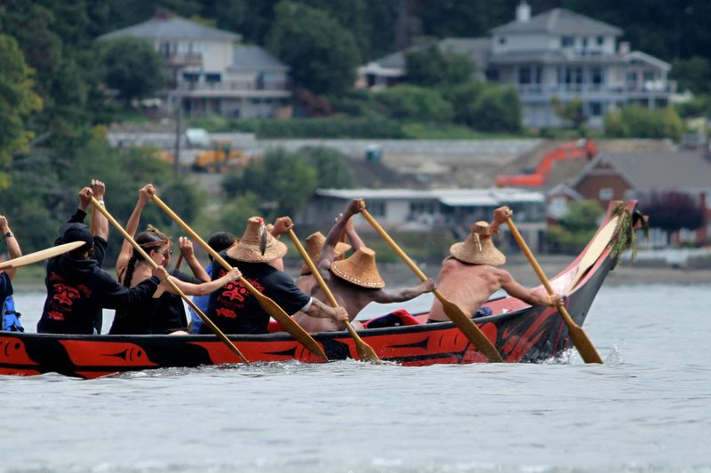 Traditional Salish canoe in Bud Inlet, heading toward the landing ceremony in Olympia. Canoe Journey 2012.