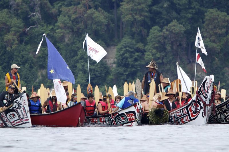 Traditional Salish canoes raft together in Bud Inlet. Canoe Journey 2012.