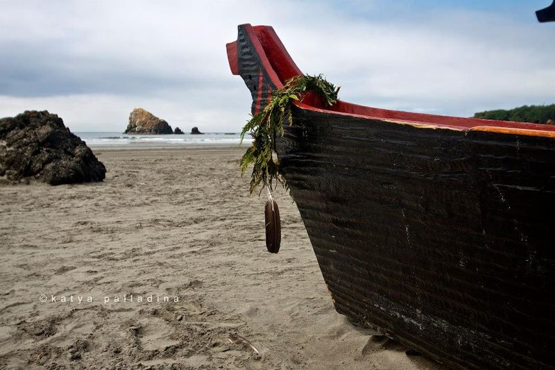 A cedar wreath hangs over the prow of a canoe.