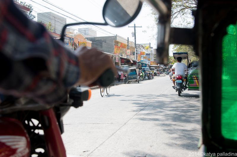 Streets of Lingayen, seen from a tricycle sidecar. Image copyright 2014 Katya Palladina.