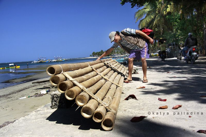Bamboo stand up paddle board, Bolinao, Philippines. Copyright Katya Palladina