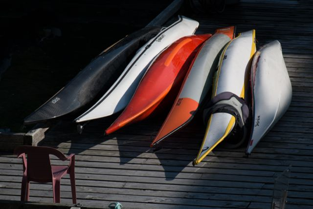 Kayaks on the boathouse dock. Photo copyright Katya Palladina.