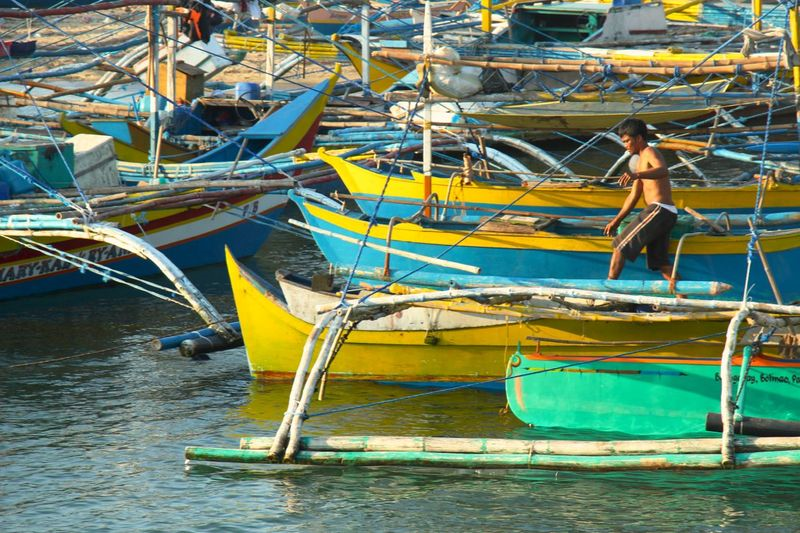 Traditional wooden fishing boats on the Balingasay River, Bolinao.
