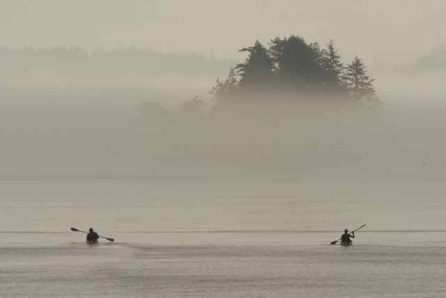 Kayakers leave White Cliff on the rising tide, heading toward Village Island and the ruins of Mamalilakulla, the Village of the Last Potlatch.