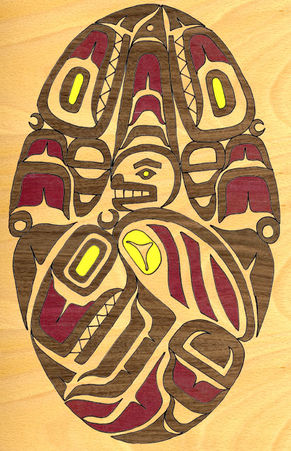 Back hatch graphic simulated in wood. Original design in the Pacific North Coast style by Andrew Elizaga