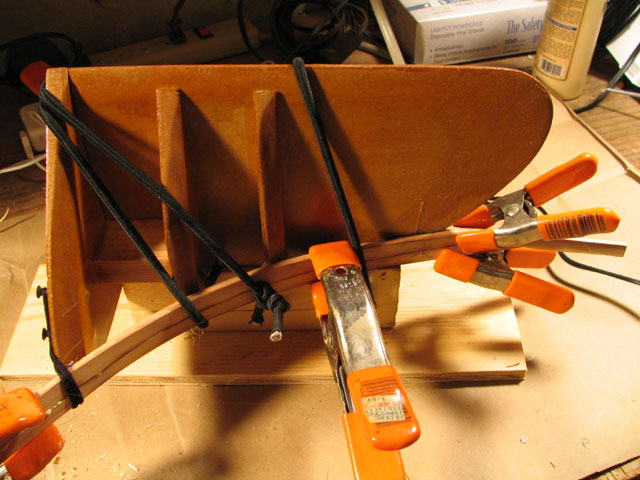 Stripping the stern on the Shooting Star cedar strip kayak. Photo Copyright ©2005 Andrew Elizaga